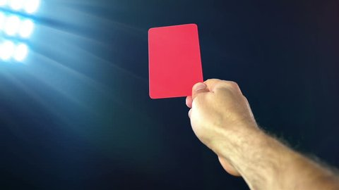 Football / soccer referee shows penalty yellow card, slow motion