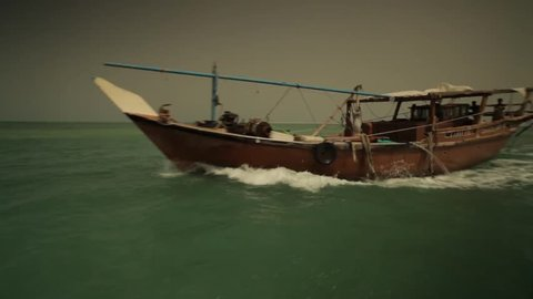 Bahrain Dhow. View from a speed boat on the Gulf Sea, of a Bahraini dhow or traditional fishing boat.