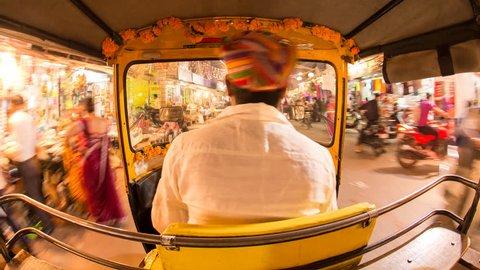 Autorickshaw POV busy illuminated old city streets, Udaipur, Rajasthan, India - 4K timelapse