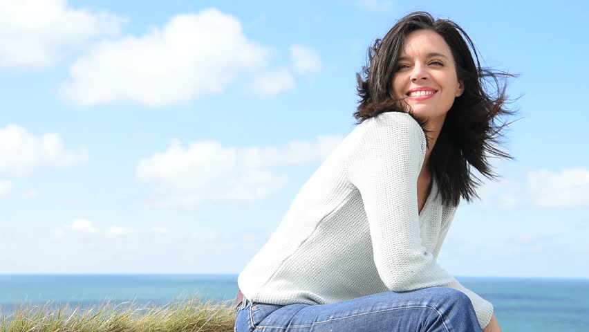 Attractive middle-aged woman by the sea