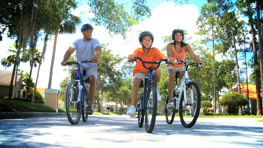 Healthy Ethnic Family Bike Riding Together