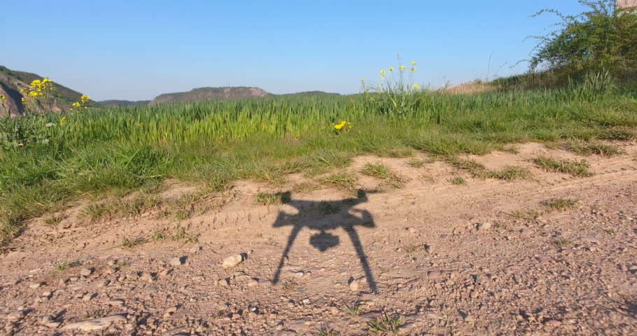 Silhouette of a drone - landing on the ground | Shutterstock HD Video #16409473