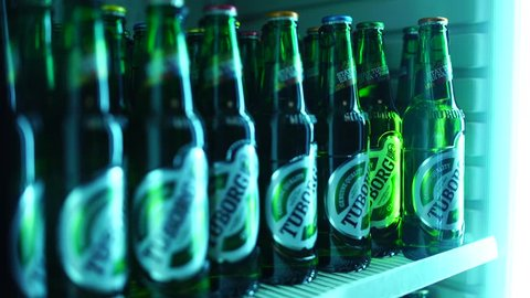 NIS, SERBIA, APRIL 2016: Beer refrigerator stocked with bottles of Tuborg beer. Tuborg is lager beer produced by Tuborg Brewery, owned by the Carlsberg group, which is Danish brewing company.