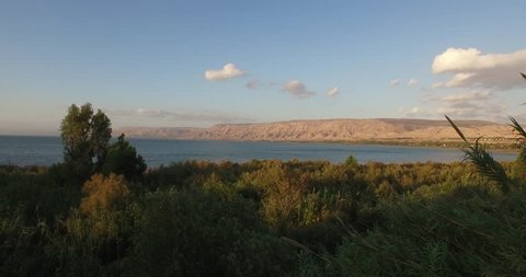 SEA OF GALILEE, Israel - 4K Aerial drone view soaring above mouth of the JORDAN RIVER. Filmed with a DJI Inspire 1 drone.