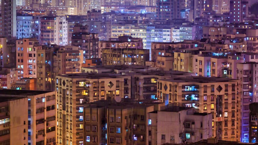 4k Timelapse. High-density apartment block houses at night, Hong Kong.