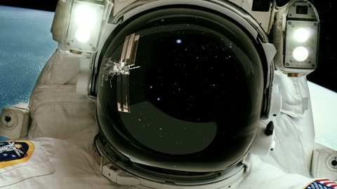 Astronaut - Planet background - Space station reflected in visor