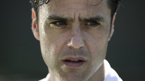 Extreme close-up of a male tennis player's sweaty face. - Model Released - 1920x1080 - Full HD