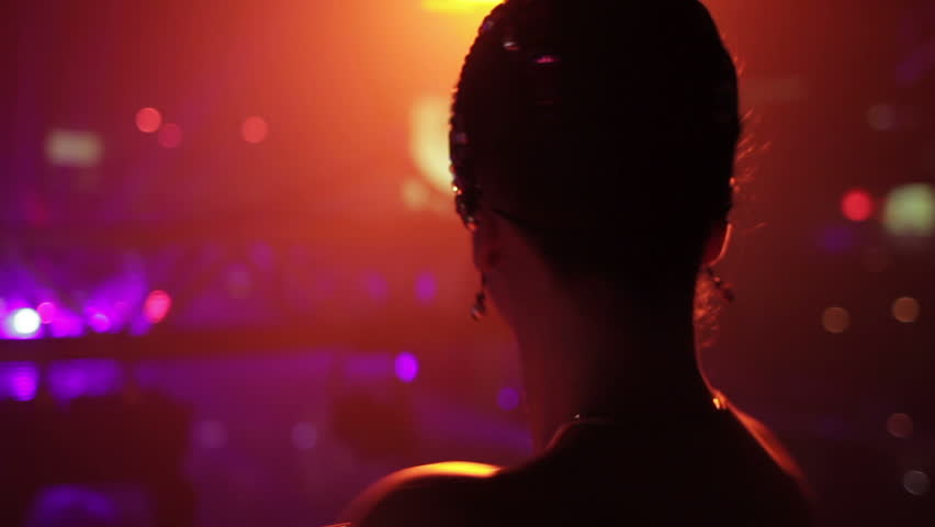 Girl dancing at night club