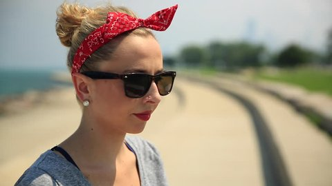 Portrait of a young woman with sunglasses and a red bandana. - Model Released - 1920x1080 - Full HD