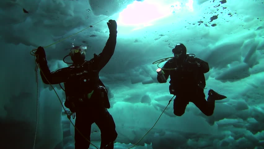 Deepsea Underwater Pole was a pioneering expedition and human adventure and scuba diving in one of the toughest climates on the planet, the North Pole. ICE CAMP BARNEO, NORTH POLE, ARCTIC - APRIL 2010 | Shutterstock HD Video #16551352