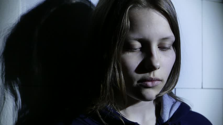 Stressed teen girl fear of something and says with gesture to do silence. 4K UHD.