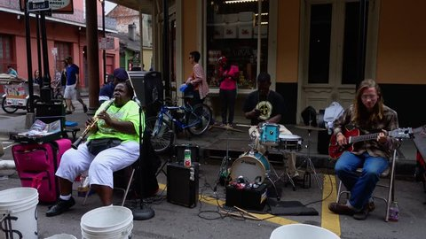 Street musicians in New Orleans French Quarter - NEW ORLEANS, LOUISIANA - APRIL 17, 2016