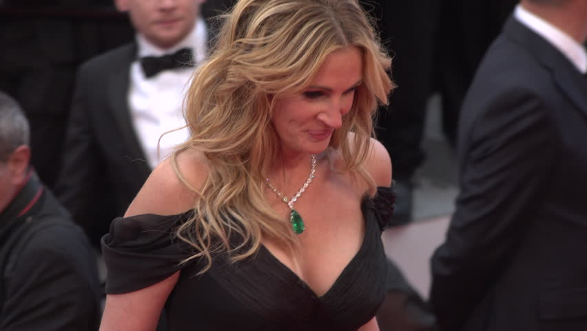 Cannes - May 12: Julia Roberts (In Armani) greeting Festival President George Miller at top of steps, close-up at the Cannes Film Festival 2016   Shutterstock HD Video #16650613
