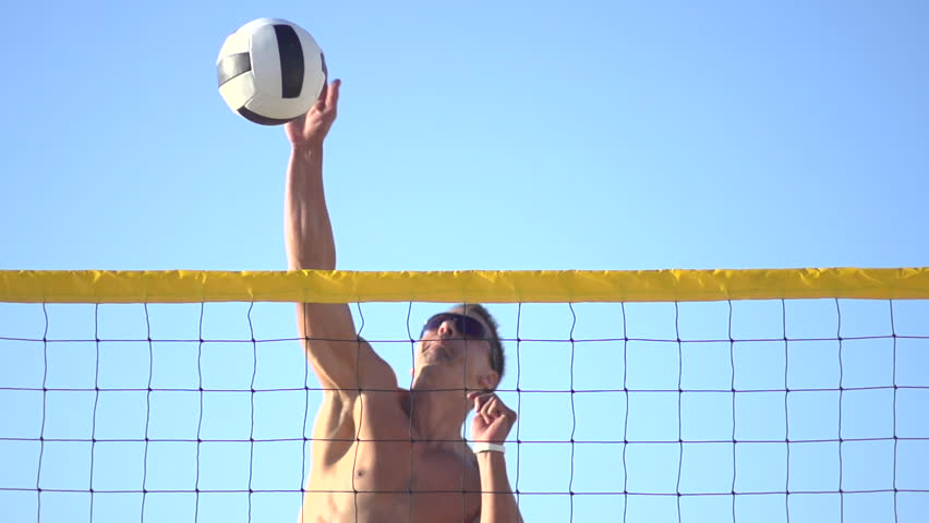 A man spiking a beach volleyball. - Super Slow Motion - Model Released - 1920x1080 - Full HD - filmed at 240 fps