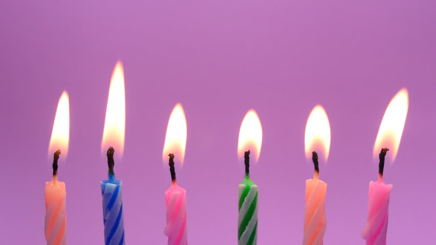 Burning Birthday Candles On Pink Background