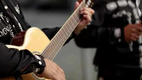 Mexican musicians mariachi on the street. Close-up of hands