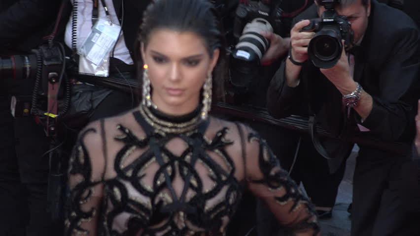 Cannes - May 15: Kendall Jenner in black and sheer patterned Roberto Cavalli gown, close up of her at the Cannes Film Festival 2016