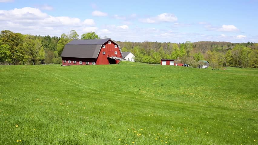 ETNA, NEW HAMPSHIRE May 18th: Sunny spring day on a classic New England Farm with red barn in Etna, New Hampshire on May 18th, 2016 in Etna, New Hampshire.