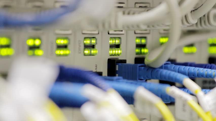 blinking LEDs on optical converters showing big traffic, technology background, internet service provider data transfer monitoring