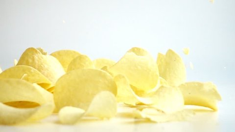 Falling Potato Chips against white background. Shot with high speed camera in slow motion.