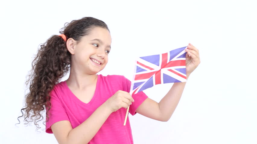 british flag held by a girl hd stock footage clip
