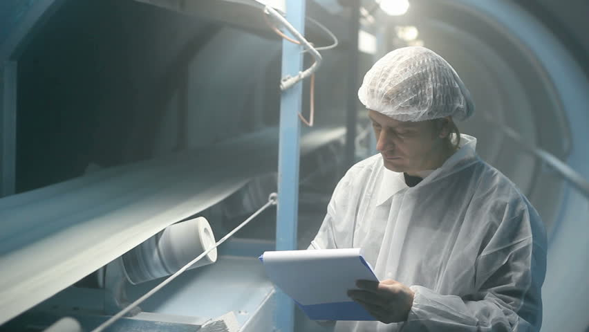 Quality inspector monitoring the process of crystal sugar production, HD 1080i.