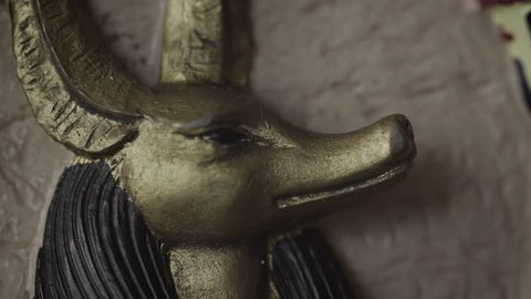 Anubis Egyptian God UHD stock footage. A close up figurine of Anubis with a slow rotating camera move.