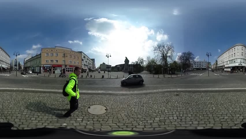 Tourist in Bright Yellow Jacket is Walking by a Road, Footpath. Young Man is Crossing Road. Paving Stone at the Road. Cars Are Driving. Panoramic View to the Park. Spherical Panorama Video, vr Video
