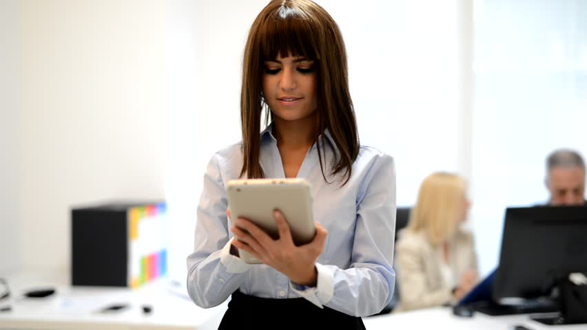 Woman using a tablet in an office | Shutterstock HD Video #16764193