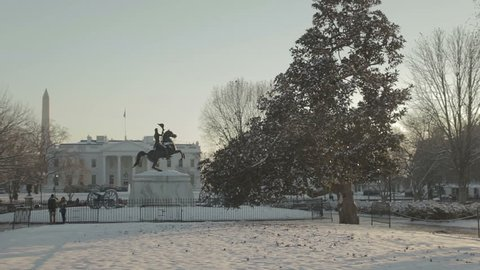 View of the White House covered in snow with Washington Monument in background. Washington DC - USA: January, 2016