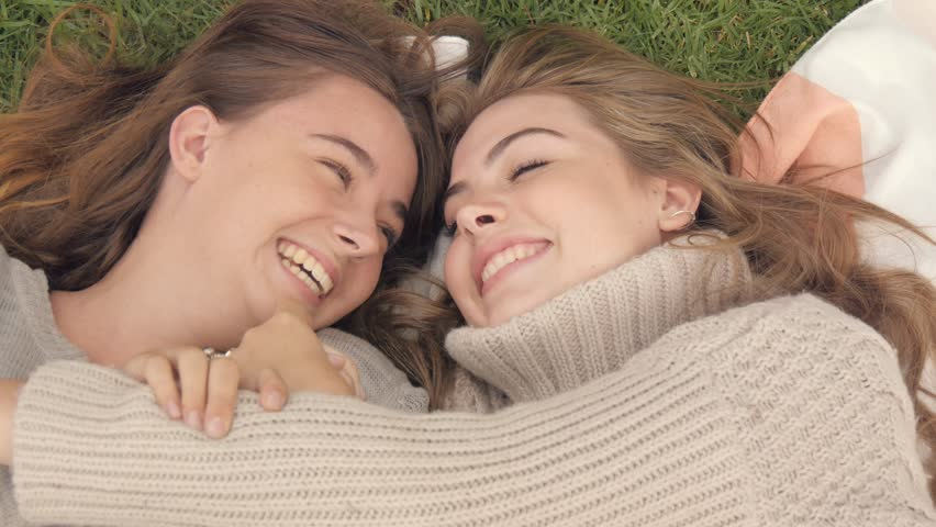 Happy best friends young woman cuddle and hug showing love and affection