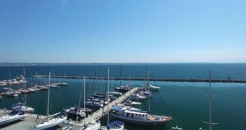 Marina with sailboats and yacht in Thessaloniki, Greece. Aerial shot with drone