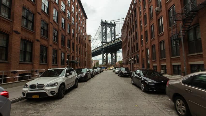 New York, USA - October 03, 2014: Manhattan Bridge viewed from narrow street, New York City, New York, USA