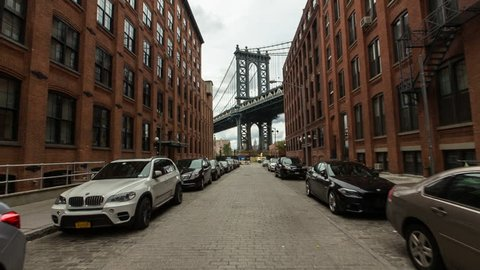 New York, USA - October 03, 2014: Manhattan Bridge viewed from narrow street, New York City, New York, USA