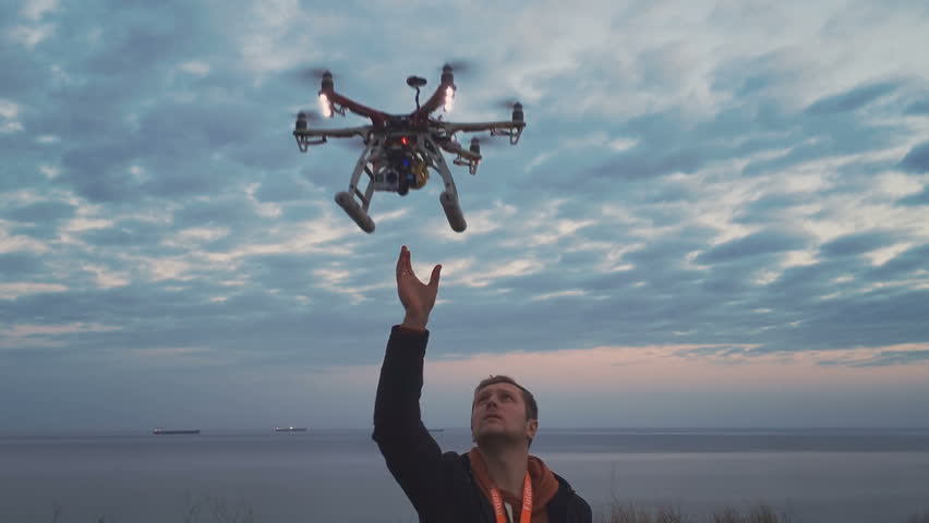 Hexacopter drone lands on your hands | Shutterstock Video #16895509