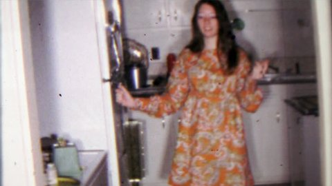 AMES, IOWA ? 1968: College student hippy girl gets creamed corn from refrigerator.