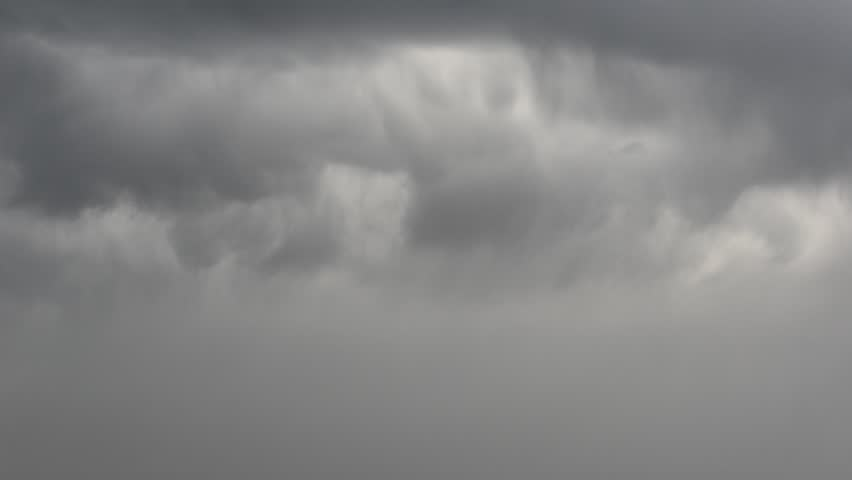 Storm clouds with rain moving in the sky.   Shutterstock HD Video #16955053