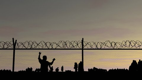 Refugees. Silhouettes of people at sunset, fence with barbed wire and iron bars! People go to the border