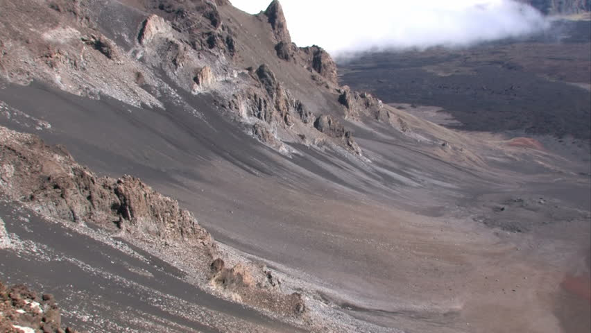 Inside of haleakala volcano crater in hawaii on the island of maui inside of haleakala volcano crater in hawaii on the island of maui volcanic cones rocks and dry lava flows dramatic landscape publicscrutiny Image collections