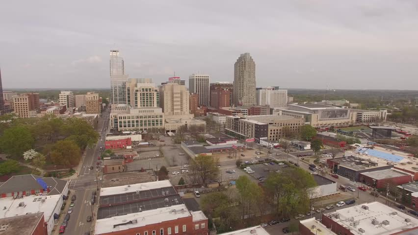 Rising aerial footage approaching downtown Raleigh, NC.