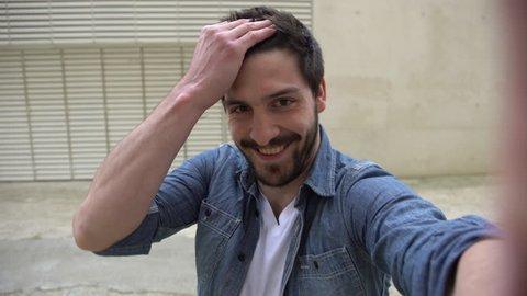Paris, France - April 14, 2016: Man posing for a selfie