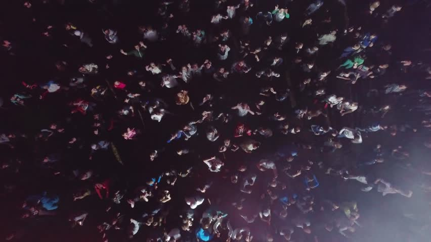 Russia, Ekaterinburg, 28 May 2016: Aerial flight above dancing, clubbing crowd on festival. Crowd of people dancing, having fun, clubbing hard at the party. People partying on a outdoors music concert