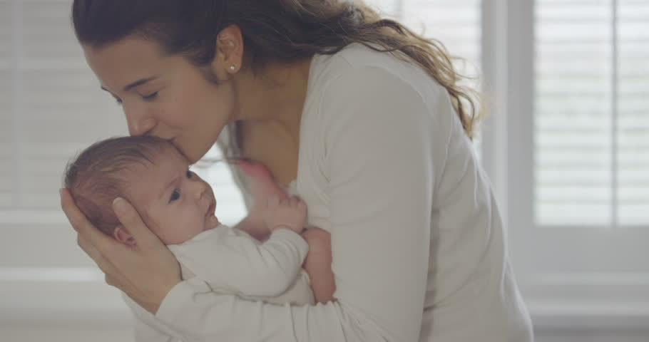 4K Portrait of new mother holding baby daughter at home, in soft natural light UK - April, 2016 | Shutterstock HD Video #17023063
