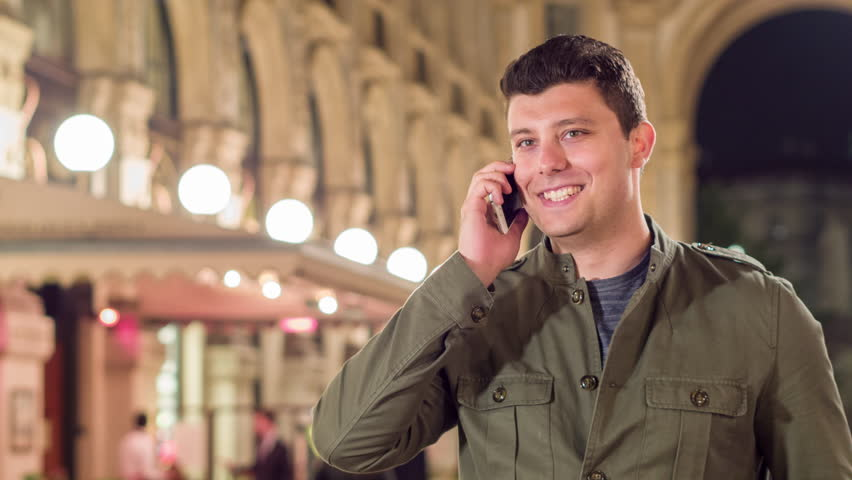 Happy Young Man Walking Through Milan Talking On Cellphone Smiling Vacation In Europe Travel Concept | Shutterstock HD Video #17032888