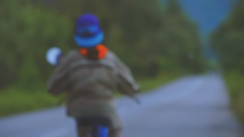 Boy Riding Motor Scooter On Road | Shutterstock HD Video #17033353