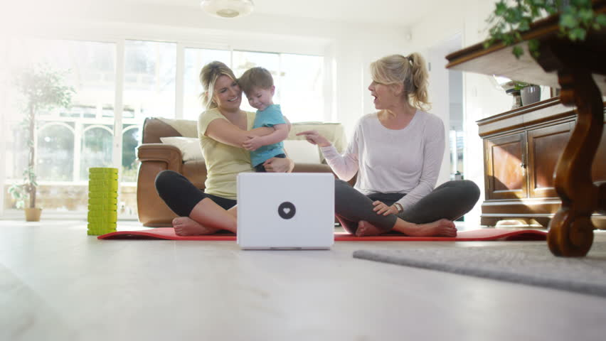 4K Portrait of women doing yoga workout together at home UK - April, 2016   Shutterstock HD Video #17048662