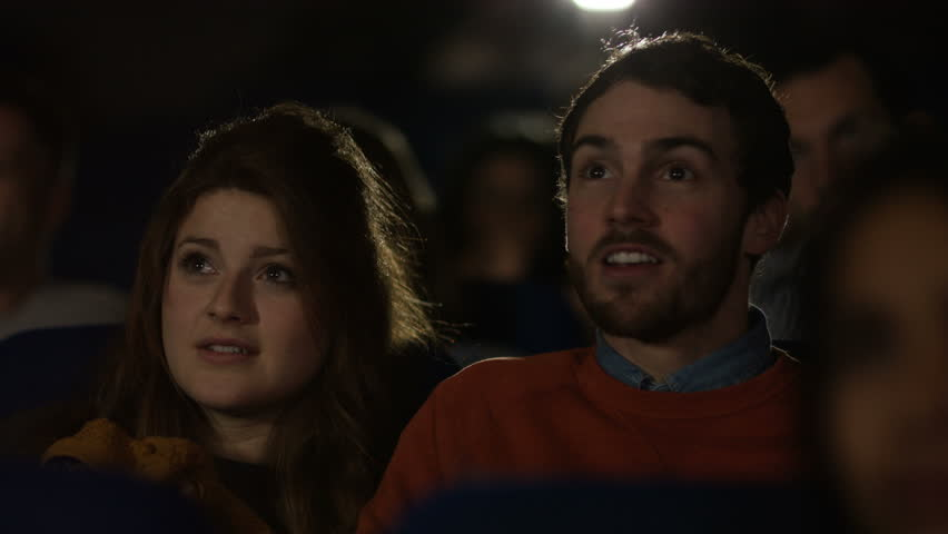 4K Cinema audience reacts to scary movie, with focus on young dating couple. Shot on RED Epic. UK - April, 2016