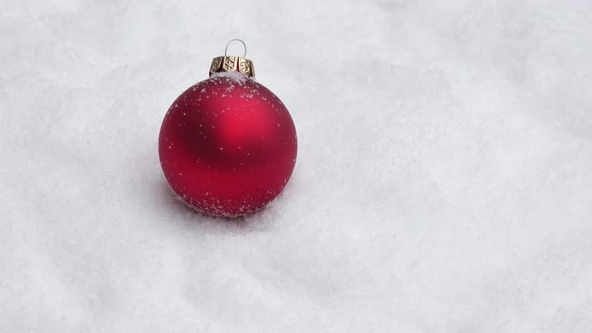 Red xmas bauble turning on snow | Shutterstock HD Video #17061133