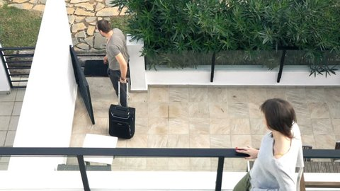 Couple break up, man going away with suitcase