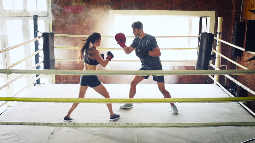 Stock video clip of man woman training gym boxing mma ring stock video clip of man woman training gym boxing mma ring shutterstock thecheapjerseys Gallery